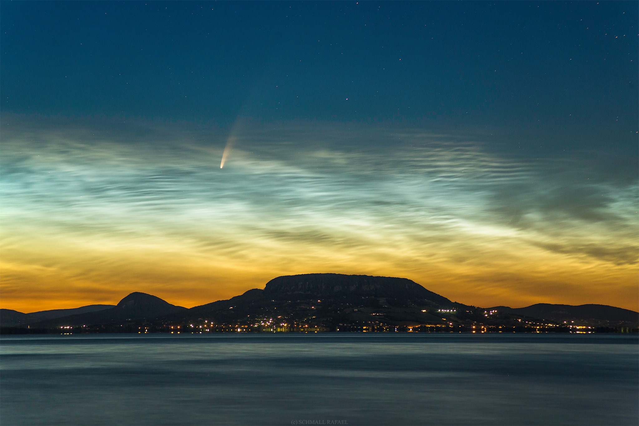 NEOWISE comet behind noctilucent clouds over Lake Balaton, Hungary